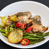 Chicken wings, roast potato and asparagus