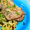 Friday dinner. Roast chicken maryland and fried cabbage. Close up.