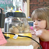 """On June 29, 2017 the Fitchburg Public Library got some eggs from """" Hatch the Chicken"""" with an incubator so that kids that came to the library could learn all about how chickens are born. On Wednesday July 19th they started to hatch and by Thursday there was only one chick that till had not come out of his shell. There were seven eggs and after they all hatch they will stay in the incubator for about 24 hours and then be moved to a bigger container where the library will have them for about two weeks for kids to see before they come back and get them. Piper Sherockman, 8, takes a good look at the newly hatched chicks on Thursday during her visit to the library. SENTINEL & ENTERPRISE/JOHN LOVE"""