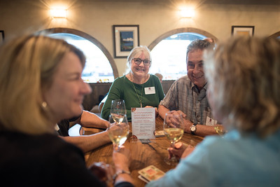 Barbara Wagoner (center left) enjoys a conversation with fellow guests at the Chico Chapter Fall Mixer at Almendra Winery on Saturday, October 14, 2017 in Chico, Calif.  (Jessica Bartlett/University Photographer)