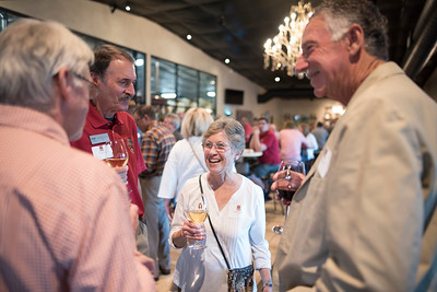 Donna Carter (center) enjoys a conversation with fellow guests at the Chico Chapter Fall Mixer at Almendra Winery on Saturday, October 14, 2017 in Chico, Calif.  (Jessica Bartlett/University Photographer)