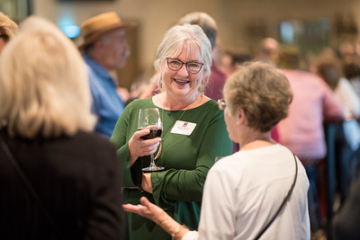 Deborah Mullins (center) enjoys a conversation at the Chico Chapter Fall Mixer at Almendra Winery on Saturday, October 14, 2017 in Chico, Calif.  (Jessica Bartlett/University Photographer)