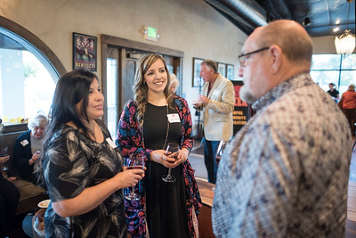 Sonia Zarate (center) enjoys a conversation with fellow guests at the Chico Chapter Fall Mixer at Almendra Winery on Saturday, October 14, 2017 in Chico, Calif.  (Jessica Bartlett/University Photographer)