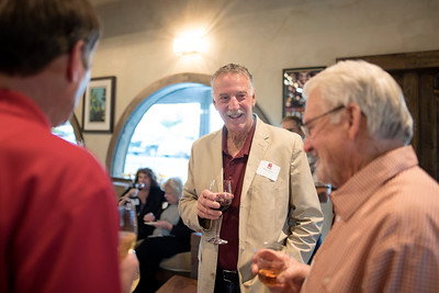 Robert Kohen (center) enjoys a conversation with fellow guests at the Chico Chapter Fall Mixer at Almendra Winery on Saturday, October 14, 2017 in Chico, Calif.  (Jessica Bartlett/University Photographer)