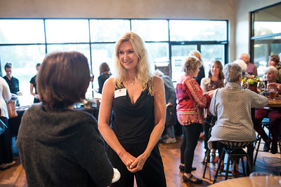 Debbie O'Sullivan (right) enjoys a conversation with a fellow guest at the Chico Chapter Fall Mixer at Almendra Winery on Saturday, October 14, 2017 in Chico, Calif.  (Jessica Bartlett/University Photographer)