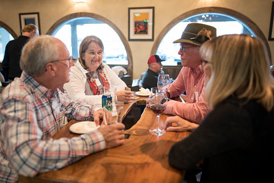 Karen Lemcke (back left) and Ross Lemcke (back right) enjoy a conversation with fellow guests at the Chico Chapter Fall Mixer at Almendra Winery on Saturday, October 14, 2017 in Chico, Calif.  (Jessica Bartlett/University Photographer)