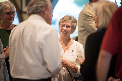 Donna Carter (center) enjoys a conversation at the Chico Chapter Fall Mixer at Almendra Winery on Saturday, October 14, 2017 in Chico, Calif.  (Jessica Bartlett/University Photographer)