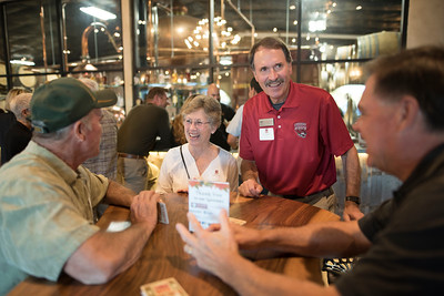 Donna Carter (center left) and Tom Carter (center right) enjoy the Chico Chapter Fall Mixer at Almendra Winery on Saturday, October 14, 2017 in Chico, Calif.  (Jessica Bartlett/University Photographer)