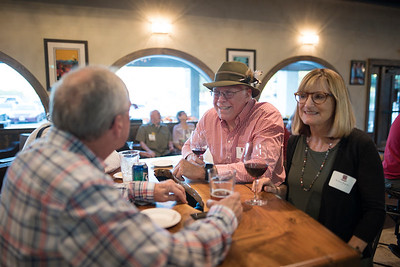 Ross Lemcke (center) and Barbara Wagoner (right) enjoy a conversation with a fellow guest at the Chico Chapter Fall Mixer at Almendra Winery on Saturday, October 14, 2017 in Chico, Calif.  (Jessica Bartlett/University Photographer)