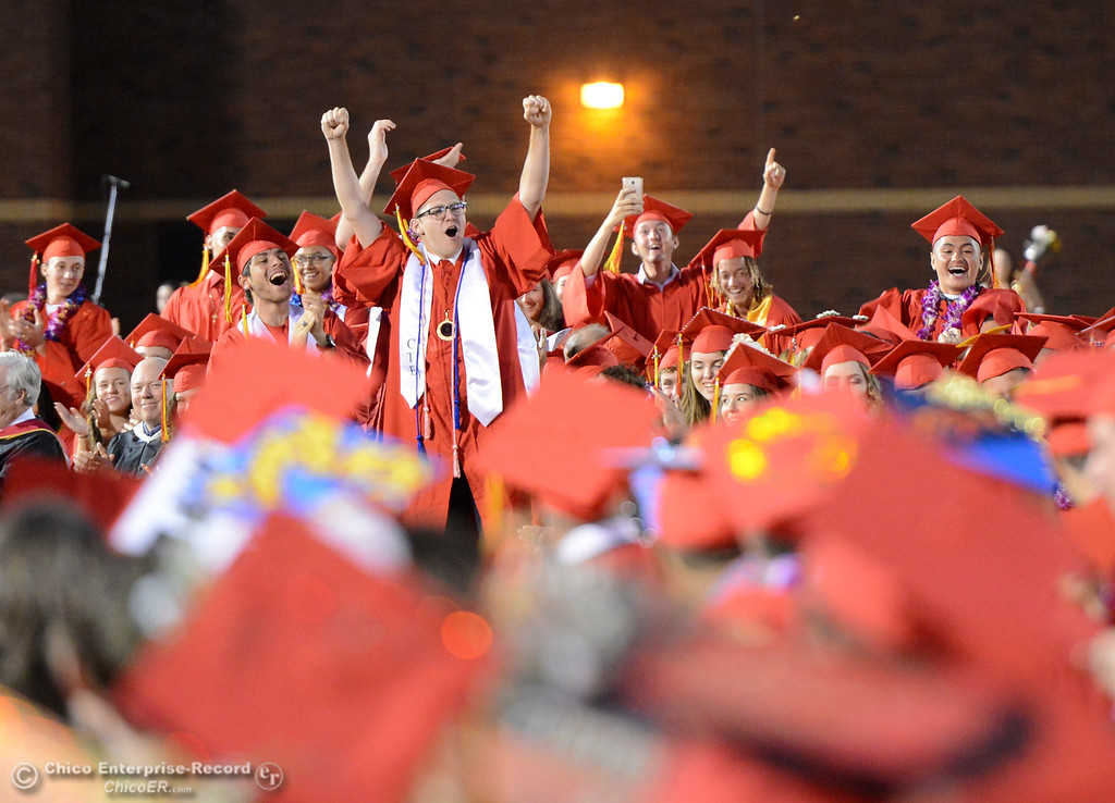 . Graduates leap to their feet and celebrate as Principal Mark Beebe announches them as the class of 2017 on Wednesday, June 7, 2017, at University Stadium in Chico, California. (Dan Reidel -- Enterprise-Record)