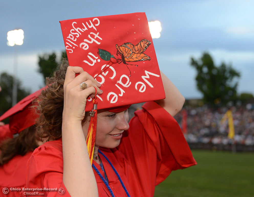 . Alena Fletcher puts her graduation cap back on after losing it to a gust of wind as seniors from Chico High School graduate Wednesday, June 7, 2017, at University Stadium in Chico, California. (Dan Reidel -- Enterprise-Record)
