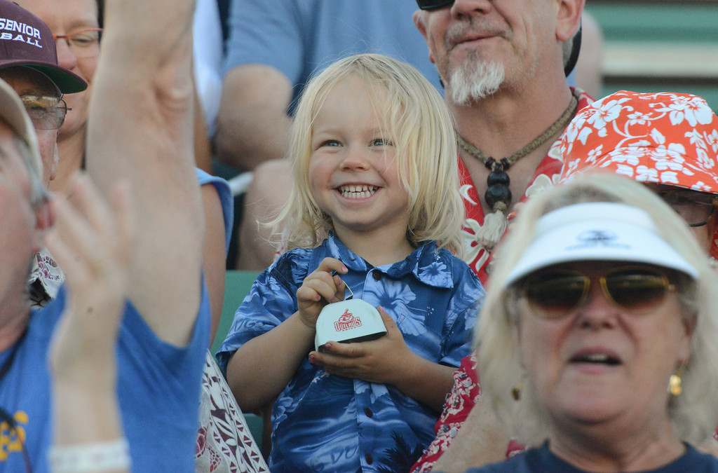 . Llewyn Wells excitedly rings a bell during the Chico Heat home opener against Klamath Falls Gems, June 1, 2018,  in Chico, California. (Carin Dorghalli -- Enterprise-Record)
