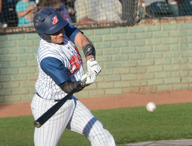 Parke Phillips hits the ball during the Chico Heat home opener against Klamath Falls Gems, June 1, 2018,  in Chico, California. (Carin Dorghalli -- Enterprise-Record)