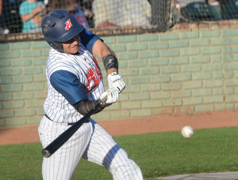. Parke Phillips hits the ball during the Chico Heat home opener against Klamath Falls Gems, June 1, 2018,  in Chico, California. (Carin Dorghalli -- Enterprise-Record)
