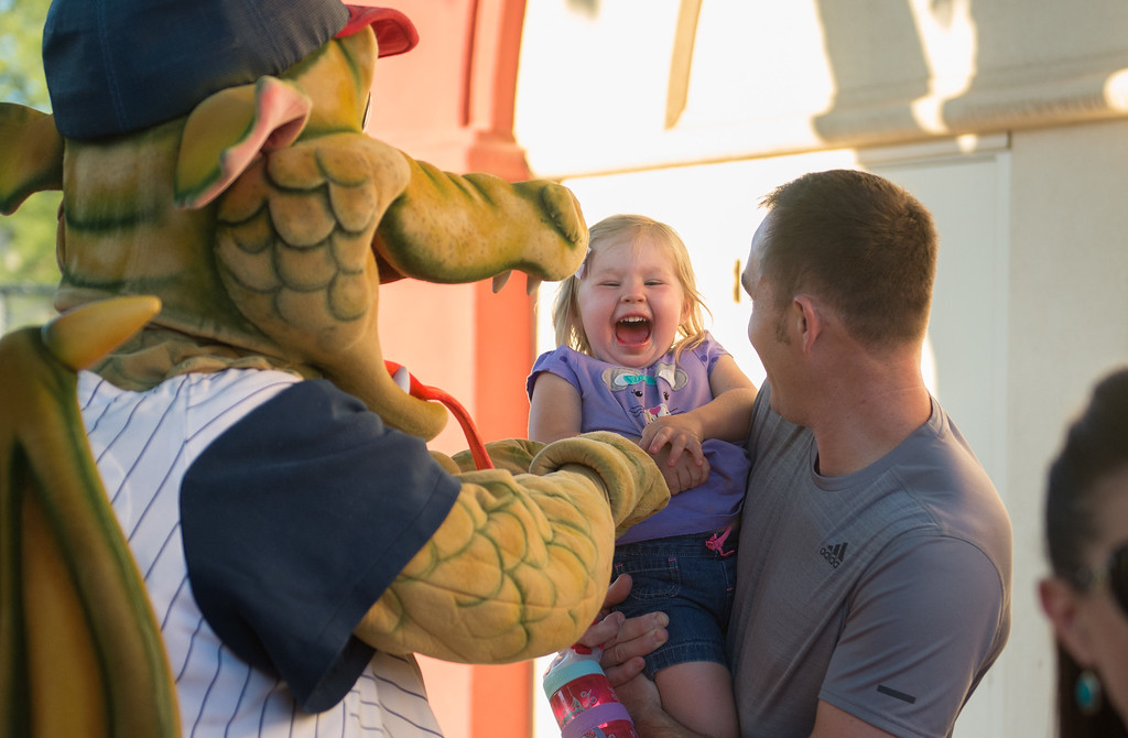 . Makenley Golden and her dad, Art Golden, are warmly greeted by Heater during the Chico Heat home opener against Klamath Falls Gems, June 1, 2018,  in Chico, California. (Carin Dorghalli -- Enterprise-Record)