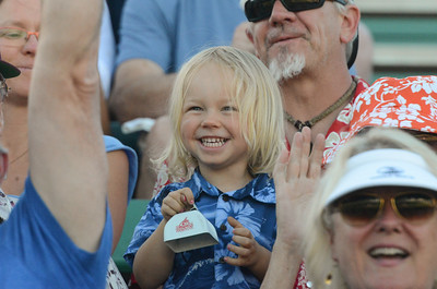 Llewyn Wells excitedly rings a bell during the Chico Heat home opener against Klamath Falls Gems, June 1, 2018,  in Chico, California. (Carin Dorghalli -- Enterprise-Record)