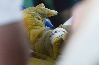 Heater signs a baseball for a fan during the Chico Heat home opener against Klamath Falls Gems, June 1, 2018,  in Chico, California. (Carin Dorghalli -- Enterprise-Record)