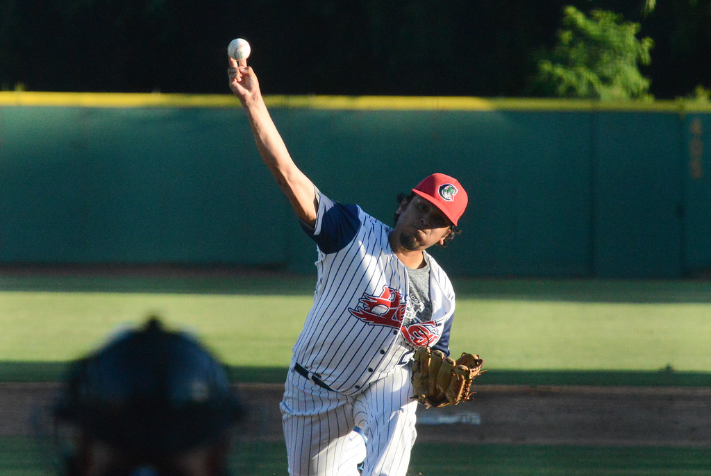 . Ryan Sanchez pitches the ball during the Chico Heat home opener against Klamath Falls Gems, June 1, 2018,  in Chico, California. (Carin Dorghalli -- Enterprise-Record)