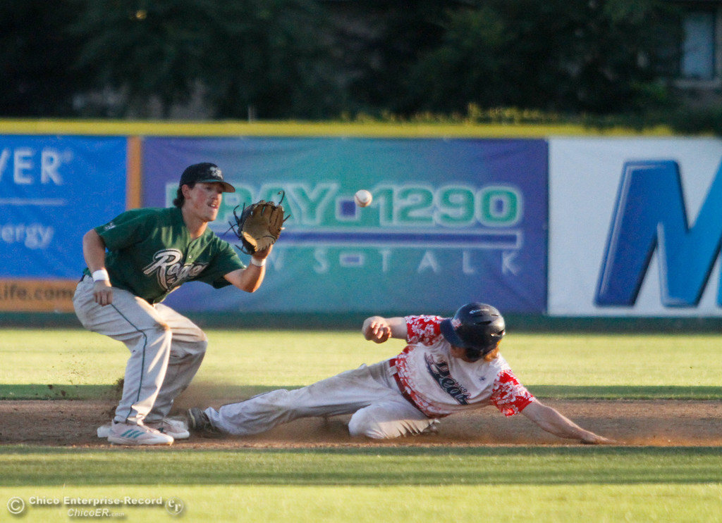 . Chico Heat\'s Cole Lemmel slides into second before Medford Rogues\' Clay Valenzuela-Reece can tag him out Friday July 14, 2017 in Chico, California.  (Emily Bertolino -- Enterprise-Record)