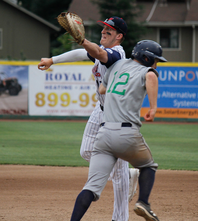 . Chico Heat\'sBailey Zimmer tries to tag Portland Pickles\'s Aidan Malm put falls to an error during the home opener against the Portland Pickles May 30, 2017 at Nettleton Stadium in Chico, California. (Emily Bertolino -- Enterprise-Record)