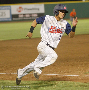 Chico Heat's Tanner Tokunaga sprints home in the fifth inning to help decrease the 6-3 deficient against the Lincoln Potters Tuesday August 8, 2017 at Nettleton Stadium in Chico, California. (Emily Bertolino -- Enterprise- Record)