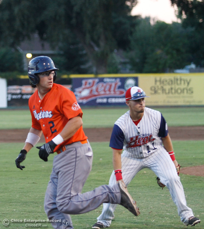 . Lincoln Potter\'s Isaiah Garcia decides to stay on third as Chico Heat\'s Brandon De La Guardia is ready to guard the base during a playoff game Tuesday August 8, 2017 at Nettleton Stadium in Chico, California. (Emily Bertolino -- Enterprise- Record)