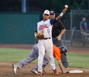 Chico Heat's Marcus Wilhite throws the ball back to the pitcher after trying to tag out Lincoln Potters' Zach Hoffman at first Tuesday August 8, 2017 at Nettleton Stadium in Chico, California. (Emily Bertolino -- Enterprise- Record)