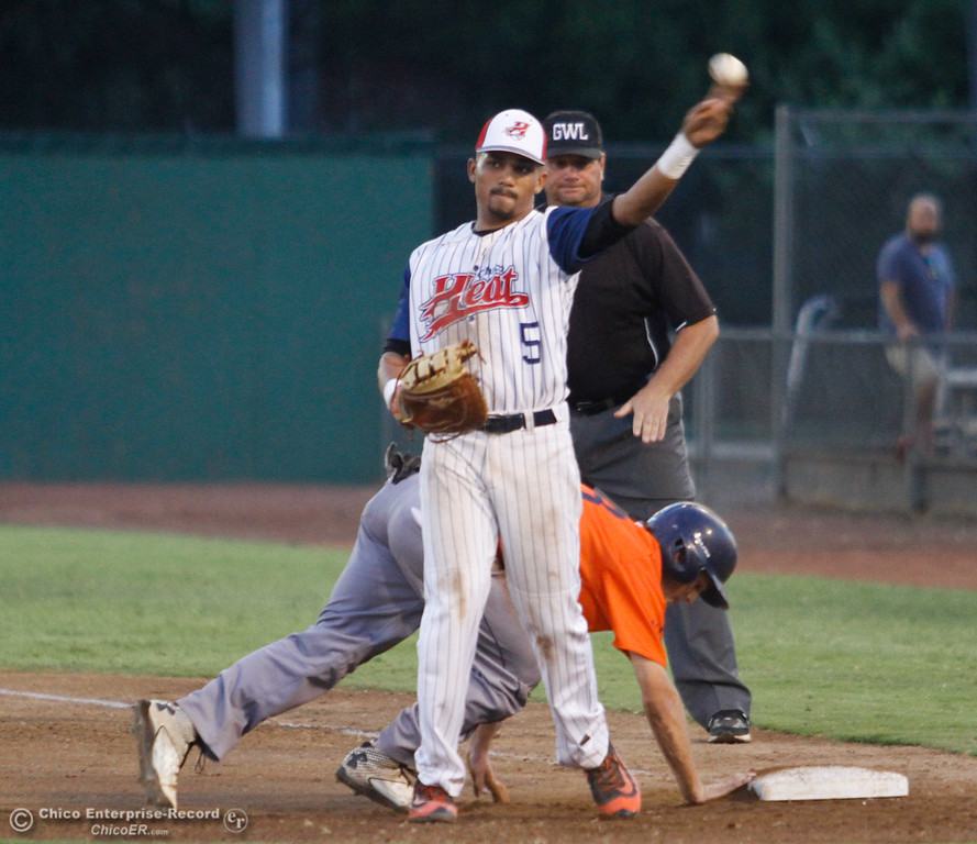. Chico Heat\'s Marcus Wilhite throws the ball back to the pitcher after trying to tag out Lincoln Potters\' Zach Hoffman at first Tuesday August 8, 2017 at Nettleton Stadium in Chico, California. (Emily Bertolino -- Enterprise- Record)