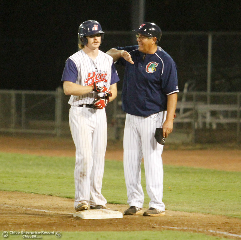. Chico Heat\'s first base coach Joe Garcia celebrates with Cole Lemmel after Lemmel knocks one into center field scoring Eric Robles as the Heat hosts the Lincoln Potters in a playoff game Tuesday August 8, 2017 at Nettleton Stadium in Chico, California. (Emily Bertolino -- Enterprise- Record)