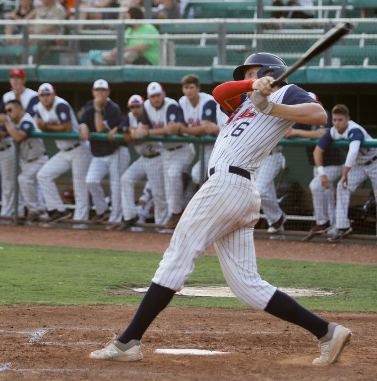 . Chico Heat\'s Bailey Zimmer watches his hit soar during a game against the Marysville Gold Sox on the third night of a three game series Saturday August 5, 2017 at Nettleton Stadium in Chico, California. (Emily Bertolino -- Enterprise- Record)