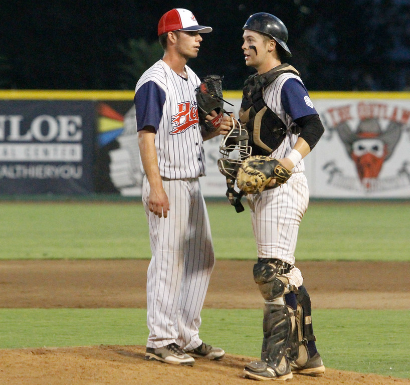 . Chico Heat\'s pitcher Tanner Clark and catcher Joe Bath talk on the mound during a game against the Marysville Gold Sox on the third night of a three game series Saturday August 5, 2017 at Nettleton Stadium in Chico, California. (Emily Bertolino -- Enterprise- Record)