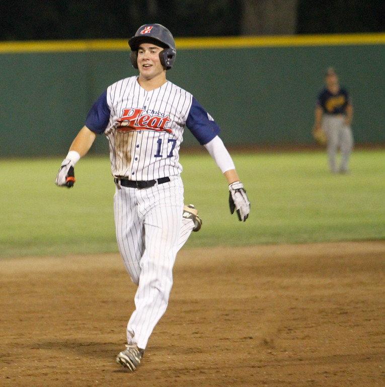 . Chico Heat\'s Tim Frith runs to third for a two run triple as the Heat hosts the Marysville Gold Sox on the third night of a three game series Saturday August 5, 2017 at Nettleton Stadium in Chico, California. (Emily Bertolino -- Enterprise- Record)