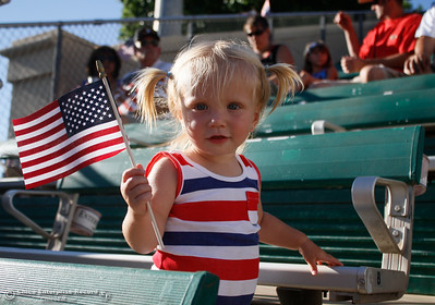 Kaycee Fleck, 18 months waves an American flag and clims around the bleachers as the Chico Heat gets ready to play the Marysville GoldSox July 4, 2017 at Nettleton Stadium in Chico, California.  (Emily Bertolino -- Enterprise-Record)
