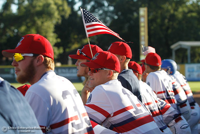 In the Chico Heat dugout players wear American flags as they hosts the Marysville GoldSox on July 4, 2017 at Nettleton Stadium in Chico, California.  (Emily Bertolino -- Enterprise-Record)