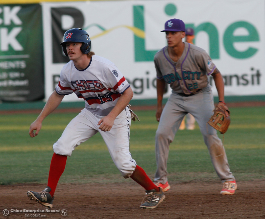 . Chico Heat\'s Cole Lemmel gets ready to run to third as Yuba City Bear\'s Shaq Robinson tries to defend Tuesday July 18, 2017 at Nettleton Stadium in Chico, California.  (Emily Bertolino -- Enterprise-Record)