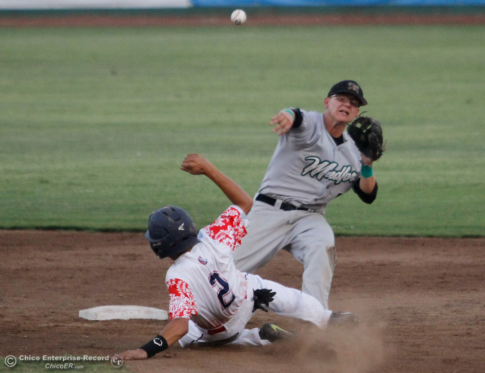 . Medford Rogues\'s Jayden Hanna tries to complete the double after tagging Chico Heat\'s Eric Robles out at first in the first game of the Great West League championship series August 11, 2017 at Nettleton Stadium in Chico, California. (Emily Bertolino -- Enterprise- Record)