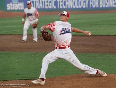 Chico Heat's Lucas Knowles pitches against the Medford Rogues in the first game of the Great West League championship series August 11, 2017 at Nettleton Stadium in Chico, California. (Emily Bertolino -- Enterprise- Record)