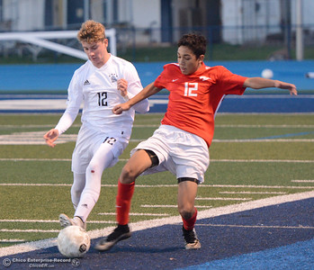 Chico High's Julian Valles, right, reaches in to steal the ball away from Pleasant Valley's Caden Crumm Friday, January 19, 2018 Asgard Yard in Chico, California. (Emily Bertolino -- Enterprise-Record)
