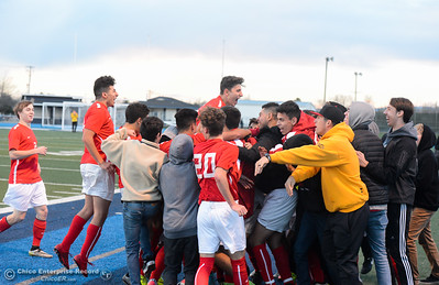 Chico High boys soccer team celebrates after upsetting Pleasant Valley High's 98 game unbeaten streak by winning 1-0 Friday, January 19, 2018 Asgard Yard in Chico, California. (Emily Bertolino -- Enterprise-Record)