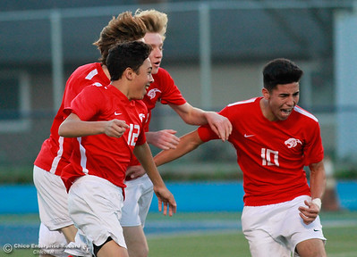 Chico High's Juan Tejeda (10) celebrates with teammates after scoring the goal that gave the Panthers a 1-0 win over Pleasant Valley High Friday, January 19, 2018 Asgard Yard in Chico, California. (Emily Bertolino -- Enterprise-Record)