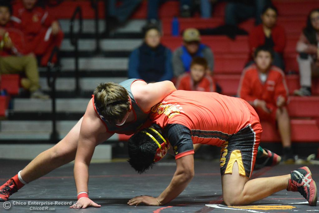 . Chico\'s Lorenzo Toribio wrestles Corning\'s Dillon Bailey in the 195 weight class Wednesday November 29, 2017 in Corning, California. (Emily Bertolino -- Enterprise-Record)