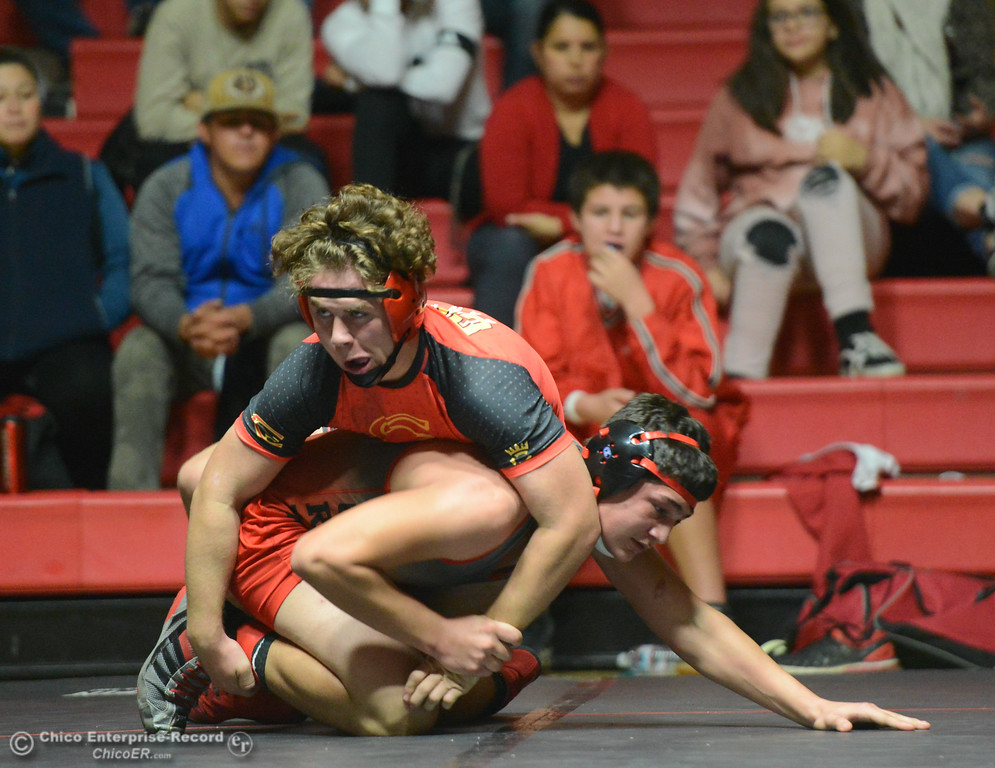. Chico\'s Bobby McCoy wrestles Corning\'s Brandon Matlock in the 182 weight class Wednesday November 29, 2017 in Corning, California. (Emily Bertolino -- Enterprise-Record)