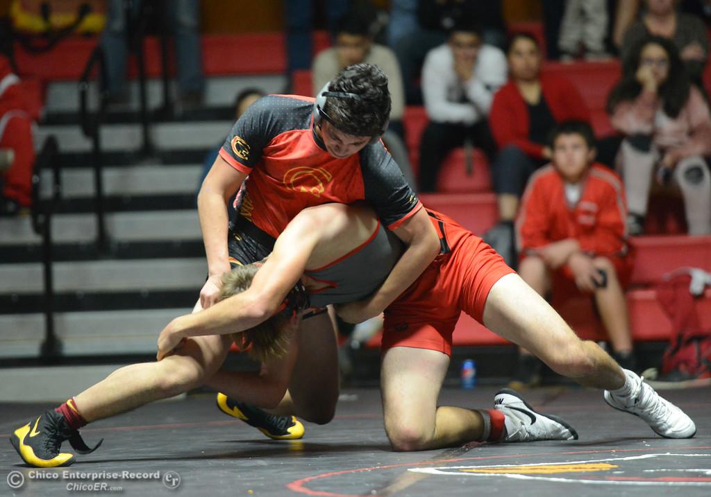 . Chico\'s Zach Soto wrestles Corning\'s Tristen Bailey in the 160 weight class Wednesday November 29, 2017 in Corning, California. (Emily Bertolino -- Enterprise-Record)