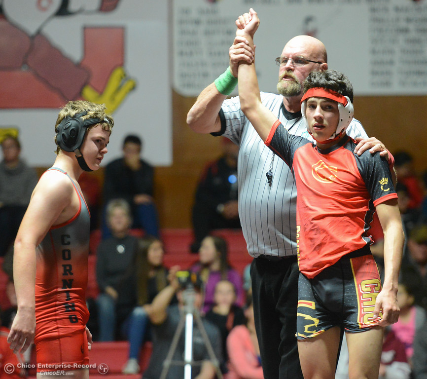 . Chico\'s Rieker Pineda wrestles Corning\'s Frank Gregorio in the 126 weight class Wednesday November 29, 2017 in Corning, California. (Emily Bertolino -- Enterprise-Record)