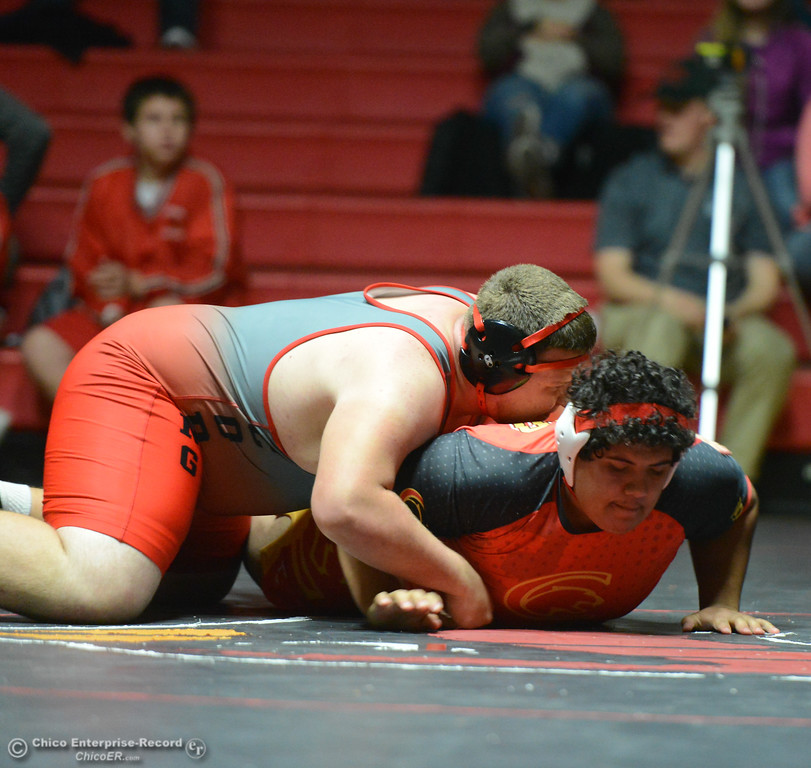 . Chico\'s Arturo Cardenas wrestles Corning\'s Anthony Ortega in the 285 weight class Wednesday November 29, 2017 in Corning, California. (Emily Bertolino -- Enterprise-Record)
