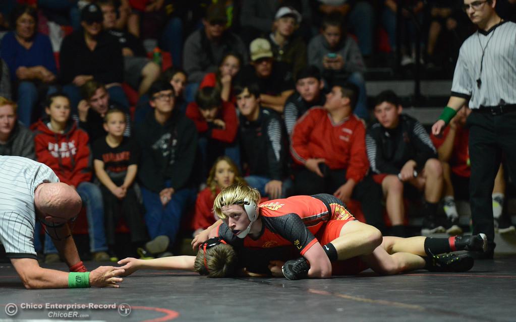 . Chico\'s Jake Stemple wrestles Corning\'s Darren Carter in the 138 weight class Wednesday November 29, 2017 in Corning, California. (Emily Bertolino -- Enterprise-Record)
