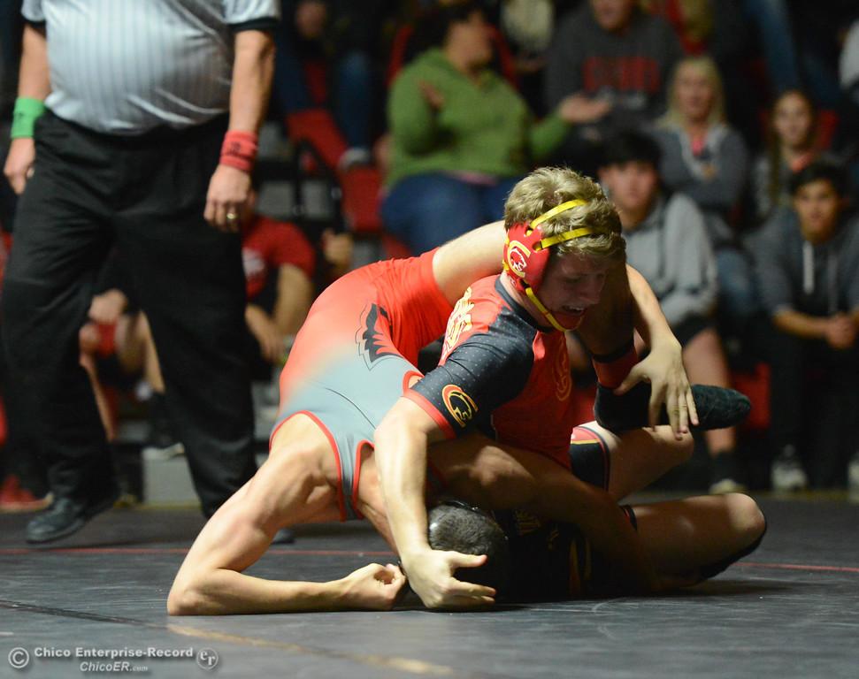 . Corning\'s Jamal Smith wrestles Chico\'s Josh Ortega  in the 152 weight class Wednesday November 29, 2017 in Corning, California. (Emily Bertolino -- Enterprise-Record)