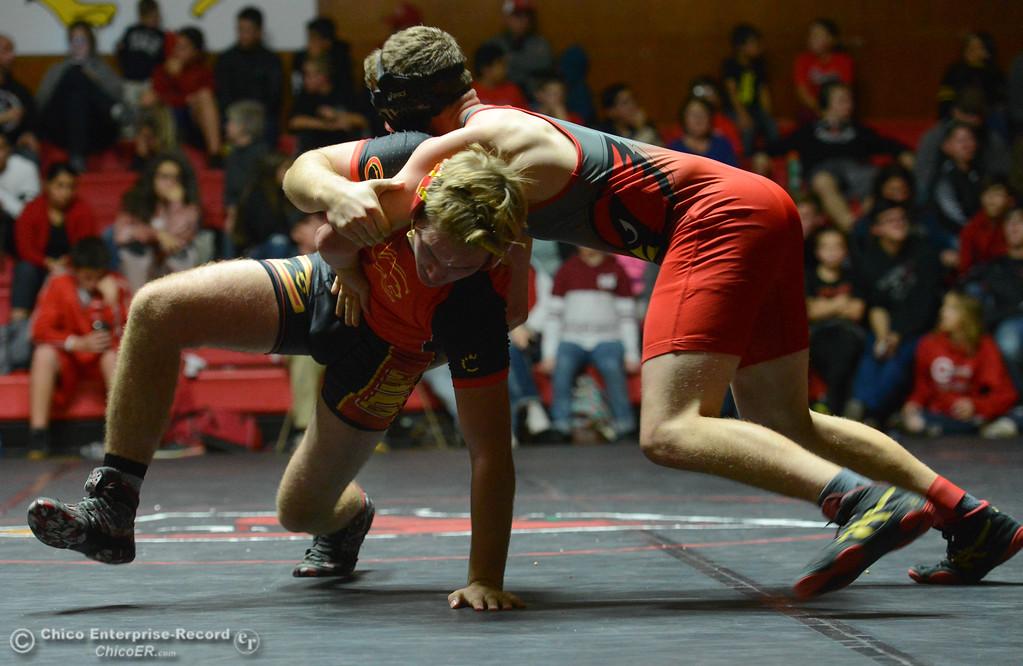 . Chico\'s Kaden Kaps wrestles Corning\'s Mitchell Albers in the 170 weight class Wednesday November 29, 2017 in Corning, California. (Emily Bertolino -- Enterprise-Record)