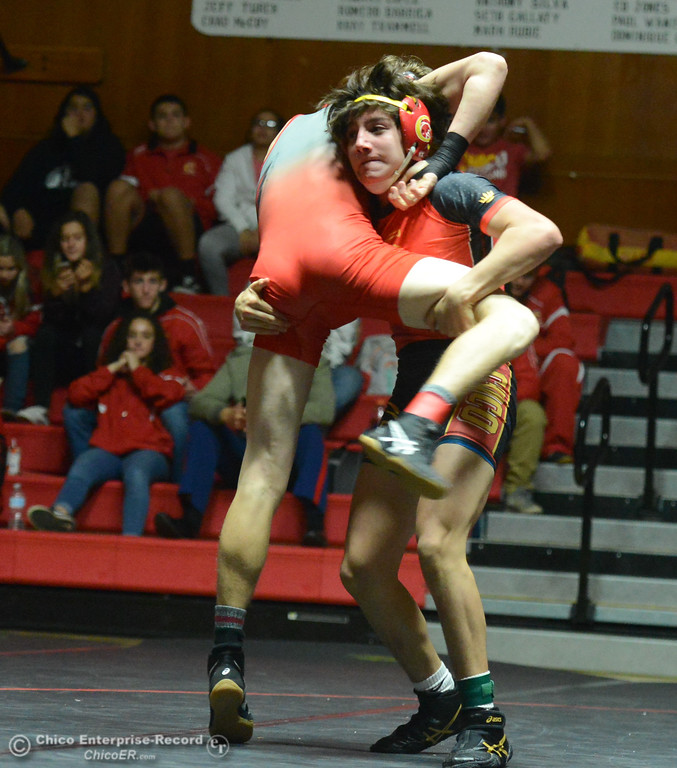 . Chico\'s Mere Chavez  wrestles Corning\'s Alex Mayer in the 132 weight class Wednesday November 29, 2017 in Corning, California. (Emily Bertolino -- Enterprise-Record)