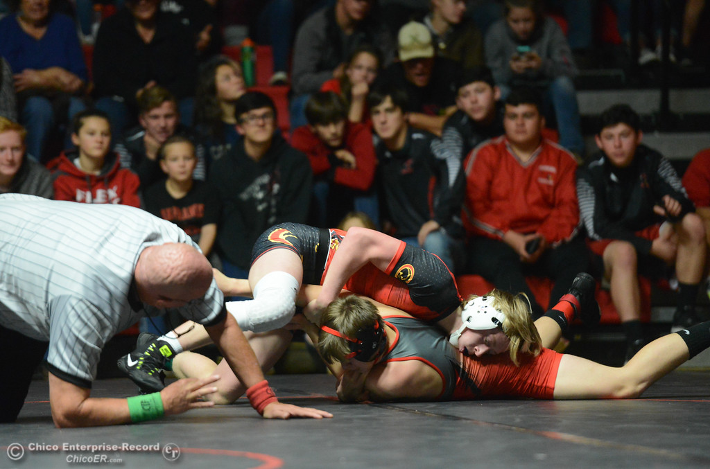 . Chico\'s Jake Stemple wrestles Corning\'s Darren Carter in the 138 weight class Wednesday November 29, 2017 in Corning, California. (Emily Bertolino -- Enterprise-Record)